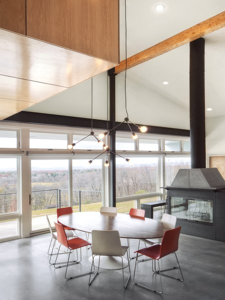 """The windows and patio doors, all made from super low-E insulated glass, open onto the amazing views and give easy access to expansive decks and a pool terrace,"" Mulvena says. His team conducted solar studies and installed a retractable screen from MechoShade that would shade the house in the summer. Photo 4 of Hudson Valley Dream Retreat modern home"