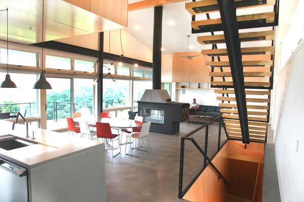 The couple plan to retire in this home; its capacious interior is designed to host multiple generations of family. IKEA lights stands over a Kohler faucet in the kitchen. Photo 5 of Hudson Valley Dream Retreat modern home