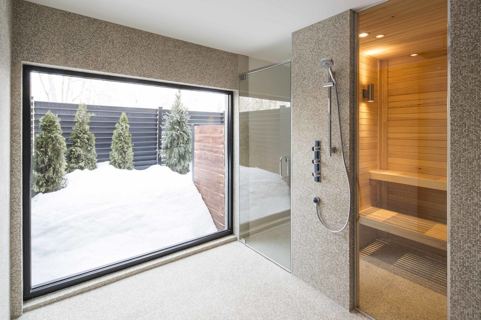 The lower floor houses a spa, gym, and office. A built-in bathroom by Espace Cuisine includes a sauna. How to Refresh a Midcentury Gem in Quebec? Winter-White Everything - Photo 12 of 12