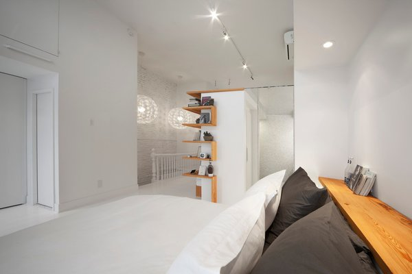 The attic transformation was undertaken as part of a larger renovation of a house that dates to the late 19th century.  Photo 3 of 6 in A Transformative Attic Renovation in Montreal