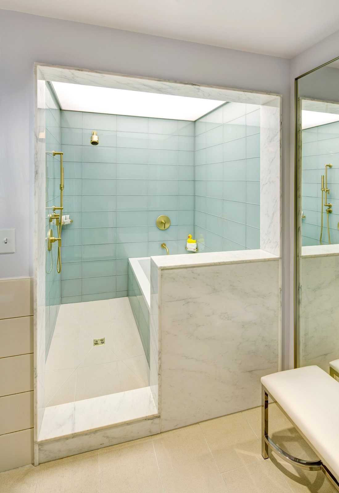 Charming Large Scale Glass Tile Lines The Shower Enclosure In The Suite Bathrooms;  Marble Surrounds