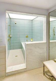 10 Best Modern Showers to Inspire Your Bathroom Renovation - Photo 3 of 10 - Architect Deborah Berke designed 21c, a modern hotel retreat located in Bentonville, Arkansas. The stunning suite bathrooms showcase large-scale glass tiles lining the shower enclosures, and are surrounded by marble—a continuation of the material theme from the lobby.