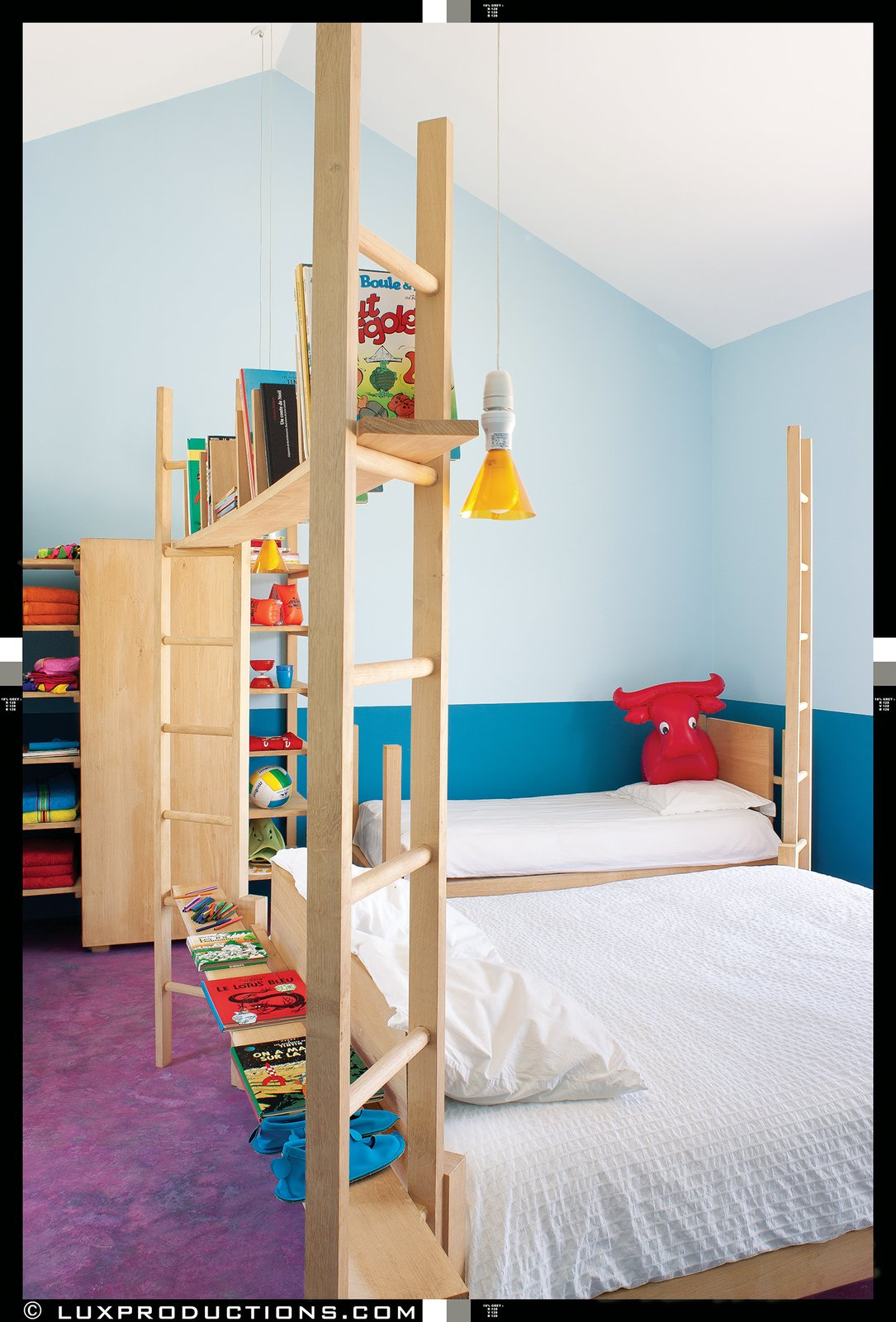 The children's rooms, which are reserved for family and an extended network of friends, feature more custom Crasset-designed beds set against a vivid blue backdrop, courtesy of the French paint brand Zolpan.  Photo 11 of 12 in Matali Crasset Renovates Monory Farmhouse