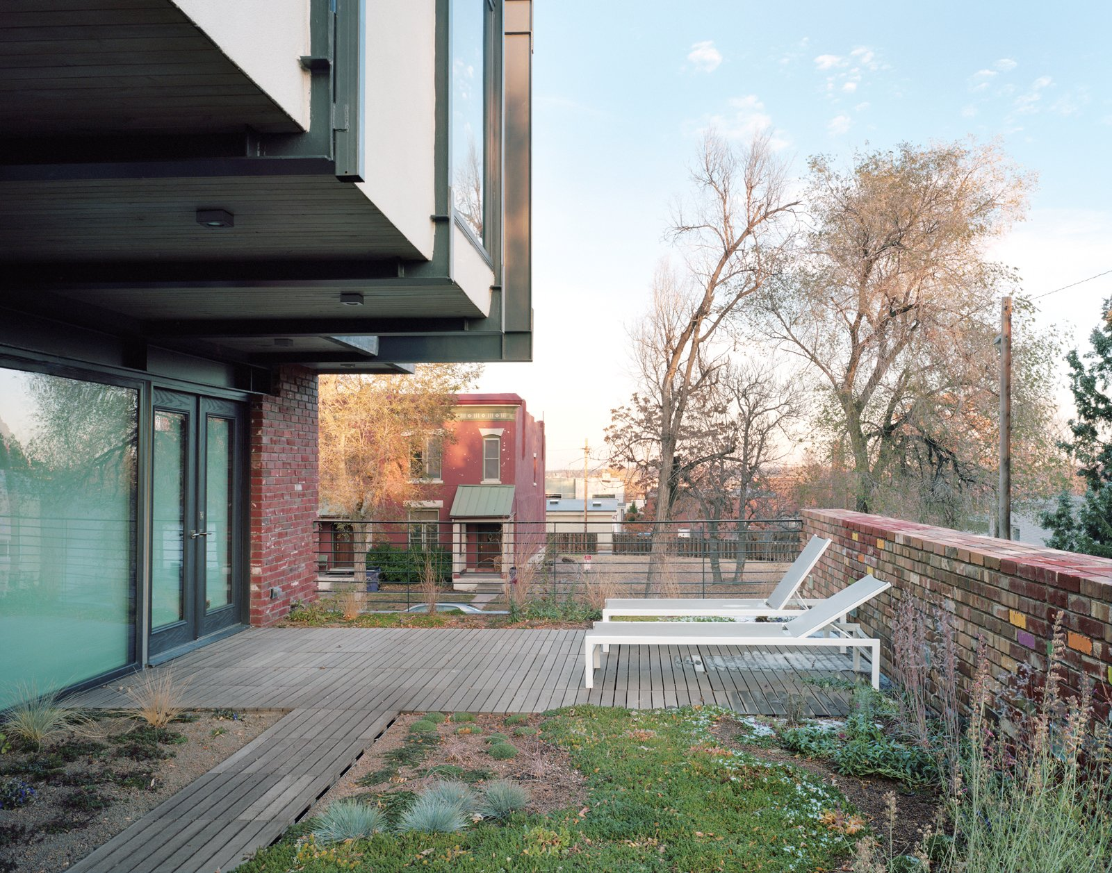 On all three aboveground levels of the house, outdoor spaces feature as prominently as indoor ones. The backyard is lined with tiered concrete boxes for planting vegetables; the modest top floor—which houses the master bedroom—has a deck wrapping three sides; and in the middle, a 770-square-foot green roof extends off the living area.  Don't miss a word of Dwell! Download our  FREE app from iTunes, friend us on Facebook, or follow us on Twitter!