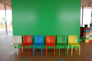 Color Me Mad! - Photo 16 of 31 - The bright-green hue of this wall, seen just inside the entrance, was used as a complementary color throughout the property.