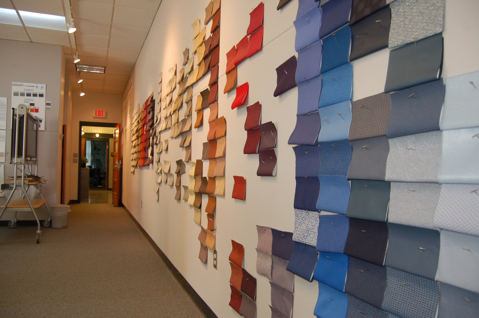 "Inside the colors and materials studio, a wall reflects a work in progress: grouping the existing textile collection into color families that progress from warm to cool and light to dark. ""Textiles are the poster children for color,"" says Lyon. ""With textiles you can combine color, texture, surface and contrast into one deliciously tactile and visual experience."""