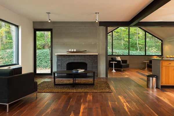 Industrial finishes include Viroc cement fiber panels over the fireplace.
