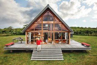 Happy 100th Birthday, Jens Risom - Photo 1 of 8 - In 2009, Dwell editor-in-chief Amanda Dameron joined Jens Risom on his return to his 1967 prefab off the coast of Rhode Island, where he's been readying it for his family's next generation. The A-framed structure, shown here, is bordered by a low stone wall, an aesthetic element that appears throughout the land.