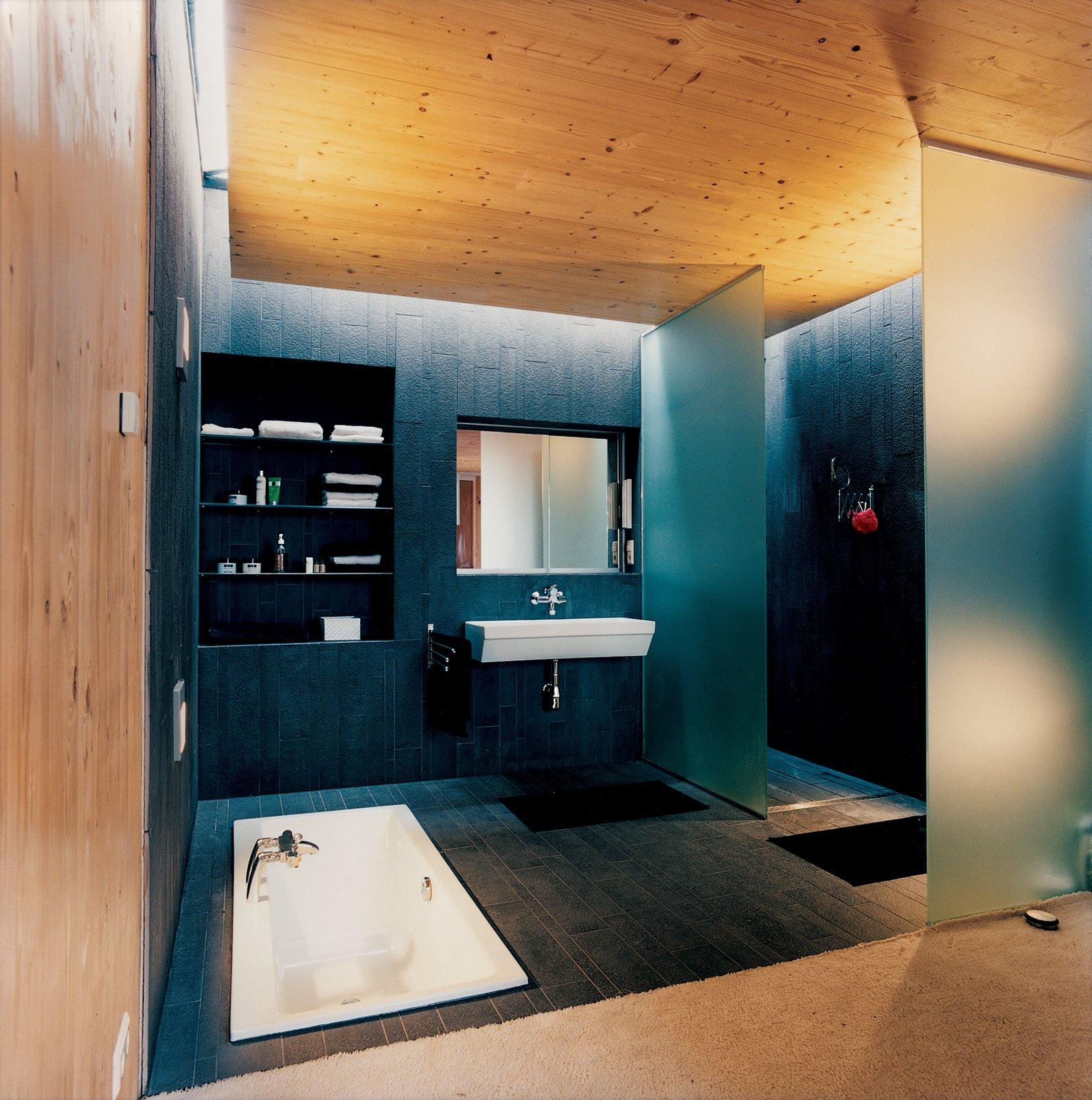 #bath #spa #bath&spa #modern #interior #interiordesign #bathroom #shower #bath #woodpanels #skylight #masterbath #laufen #sunkenbath   Photo by Hertha Hurnaus   Photo 8 of 22 in Bath & Spa Intrigue from Bath