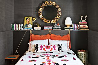 Jonathan Adler and Simon Doonan Go Trippy Contemporary on Shelter Island - Photo 8 of 12 - Adler's Slate grass cloth, a material he likes because it feels natural, sheathes a guest room's walls. Ravello and Nixon side tables flank the bed, which is covered with Adler's Alexander duvet. A reissued mirror by renowned metal artist C. Jere rounds out the eclectic room.