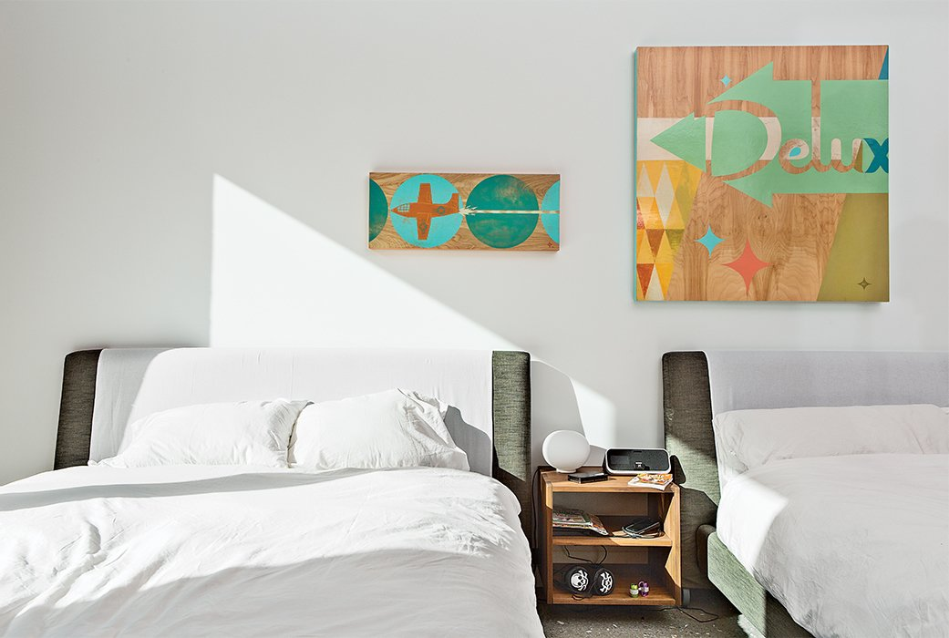 The children's bedroom, which is located next to the playroom, has beds from Bensen and artworks by Aaron Eskridge from Just Modern.