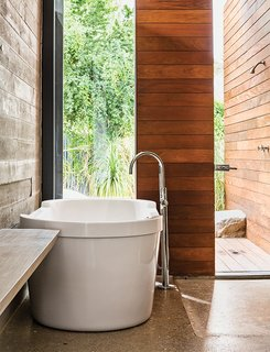 One Canadian Family Beats the Cold by Escaping to Palm Springs - Photo 10 of 12 - In the master bath, a Dornbracht tub filler is paired with a tub by Philippe Starck for Duravit.