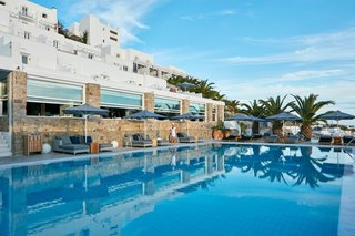 Everywhere you turn on the resort's property, your eye is drawn to the water. The classic Greek structure stands aside a sleek pool that looks out to the Aegean Sea.