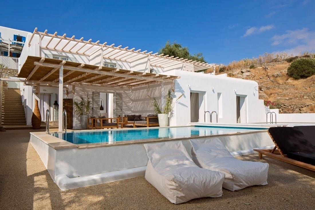 The villa is where you'll find a true celebration of island living. Designed to transition from an oasis of privacy to an entertaining hub, it's built to fit up to 22 people. This Revived Greek Resort Will Soon Be at the Top of Your List - Photo 5 of 12