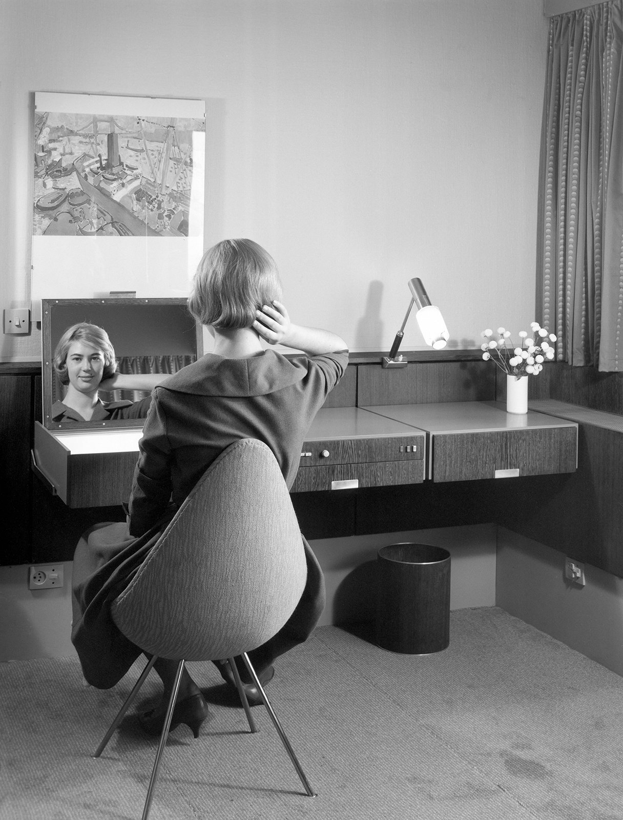 Arne Jacobsen designed nearly every element of the hotel, including the built-ins, textiles, and accessories. In addition to furnishing the rooms with existing pieces from his portfolio, Jacobsen created new pieces for the hotel, like the Drop chair shown in this archival photo.
