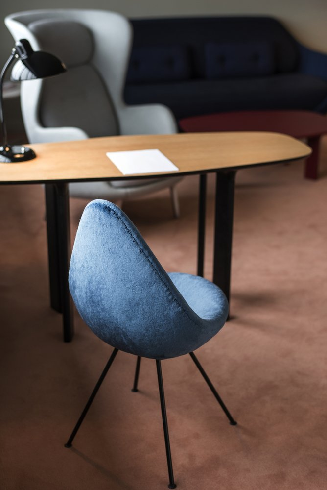 A limited number of Drop chairs were made for the hotel, then production ceased. In 2014, Fritz Hansen revived the design. Hayon upholstered this particular one with bold, blue fur. Jaime Hayon is Given the Keys to an Iconic Copenhagen Hotel - Photo 5 of 10