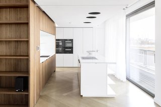 Aspirational Penthouse Living, Berlin Style - Photo 1 of 5 - The kitchen, with a custom island by the architects, has a Blanco sink and Dornbracht fixtures.