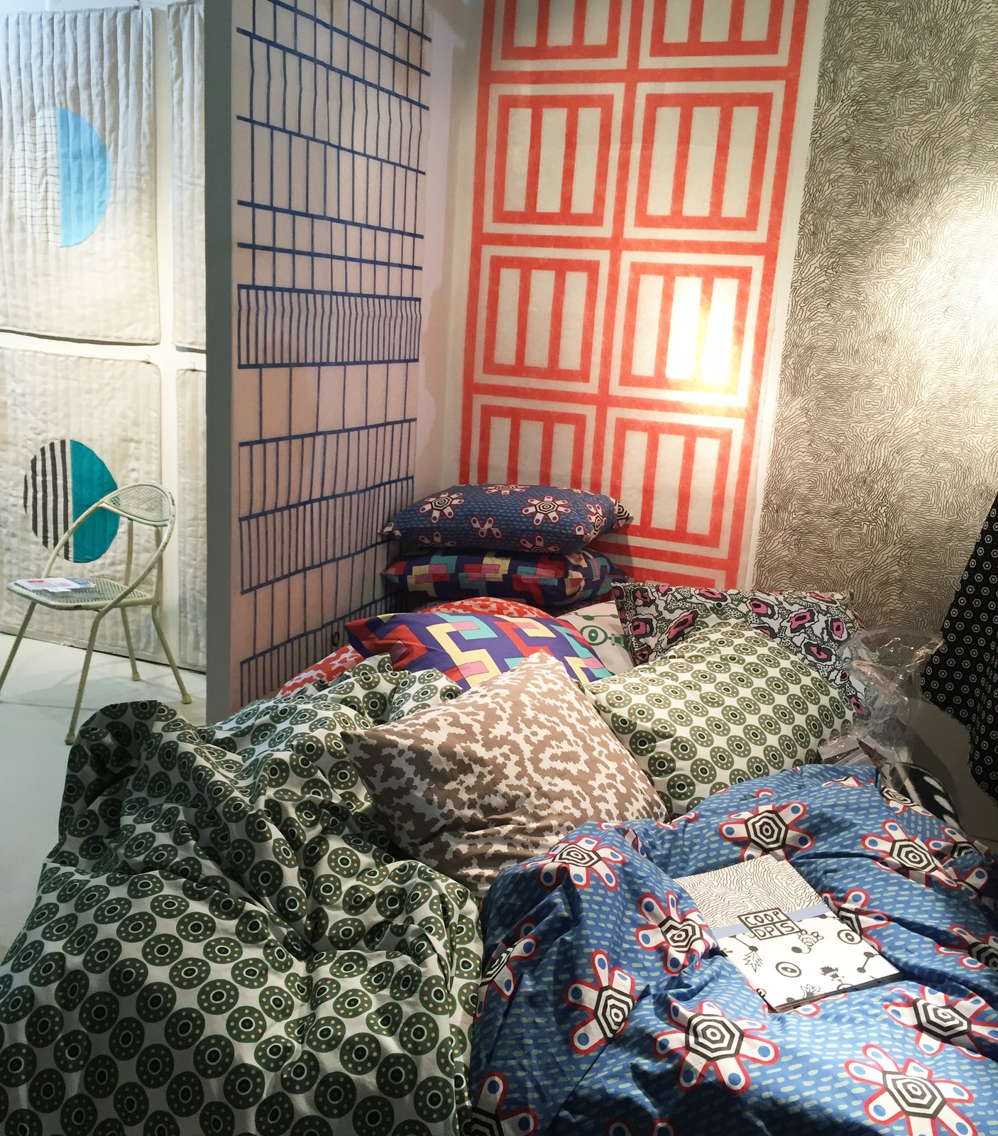 From ZigZag Zurich's colorful booth, the CoopDPS collection of wallpaper, fabric, and bedding was designed by Nathalie Du Pasquier and George Sowden, two of the founding members of the Memphis Design group. #DwellNow #sightunseenoffsite #zigzagzurich #coopdps #memphisdesign #pattern #bedding #wallpaper #color #nathaliedupasquier #georgesowden