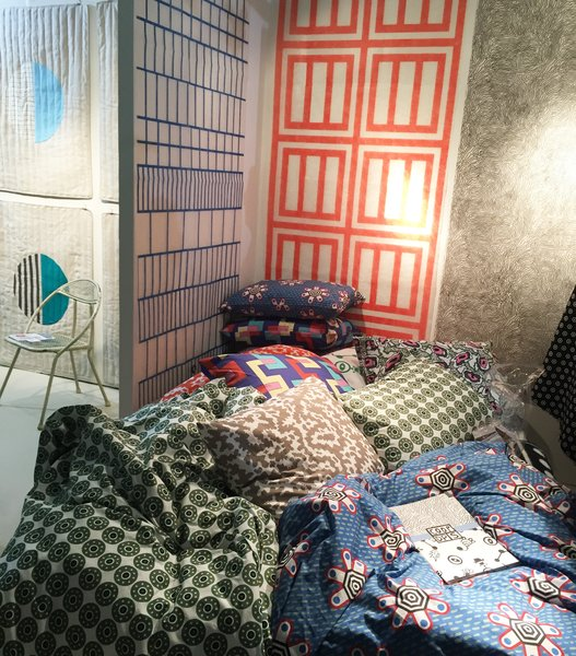 """From ZigZag Zurich's colorful booth, the CoopDPS collection of wallpaper, fabric, and bedding was designed by Nathalie Du Pasquier and George Sowden, two of the founding members of the Memphis Design group.<span> <a href=""""/discover/DwellNow"""" target=""""_blank"""">#DwellNow</a></span><span> <a href=""""/discover/sightunseenoffsite"""" target=""""_blank"""">#sightunseenoffsite</a></span><span> <a href=""""/discover/zigzagzurich"""" target=""""_blank"""">#zigzagzurich</a></span><span> <a href=""""/discover/coopdps"""" target=""""_blank"""">#coopdps</a></span><span> <a href=""""/discover/memphisdesign"""" target=""""_blank"""">#memphisdesign</a></span><span> <a href=""""/discover/pattern"""" target=""""_blank"""">#pattern</a></span><span> <a href=""""/discover/bedding"""" target=""""_blank"""">#bedding</a></span><span> <a href=""""/discover/wallpaper"""" target=""""_blank"""">#wallpaper</a></span><span> <a href=""""/discover/color"""" target=""""_blank"""">#color</a></span><span> <a href=""""/discover/nathaliedupasquier"""" target=""""_blank"""">#nathaliedupasquier</a></span><span> <a href=""""/discover/georgesowden"""" target=""""_blank"""">#georgesowden</a></span>"""