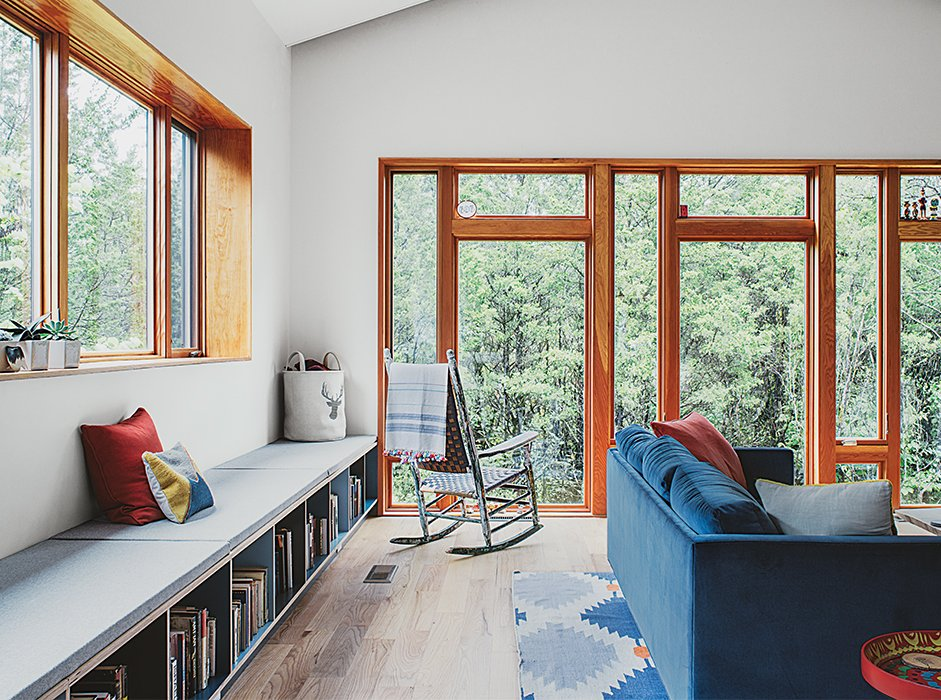 #seatingdesign #seating #livingroom #interior #inside #indoor #bench #couch #rockingchair #cedar #steel #Tennessee #rug #window #light   Photo courtesy of Ross Mantle