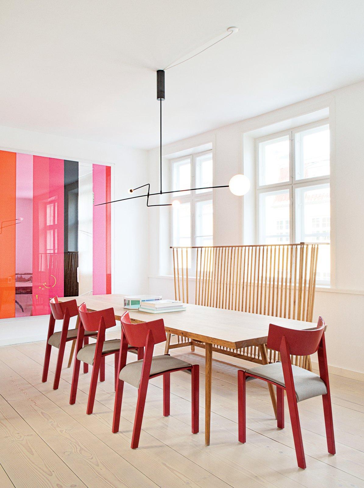 #seatingdesign #seating #diningroom #diningtable #table #chairs #color #modern #contemporary #minimalist #apartment #showroom #MobileChandelier3 #MichaelAnastassiades #KøbenhavnsMøbelsnedkeri #Vintage #red #color #RalfLindberg #IlseCrawford #DeLaEspada   Photo courtesy of the Apartment  100+ Best Modern Seating Designs by Dwell