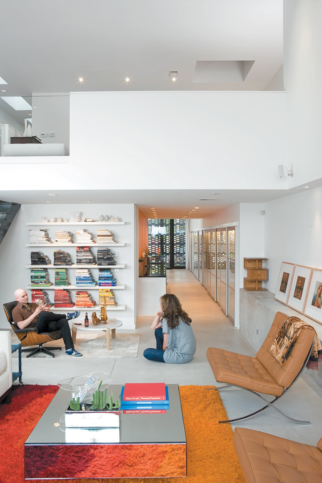 Since Dwell last visited the couple, they now have a daughter and one chair in particular is in constant competition.  Hallways That Impress by Ethan Lance from This is How You Combine Modern Architecture, Flea Market Finds, and Art All Together