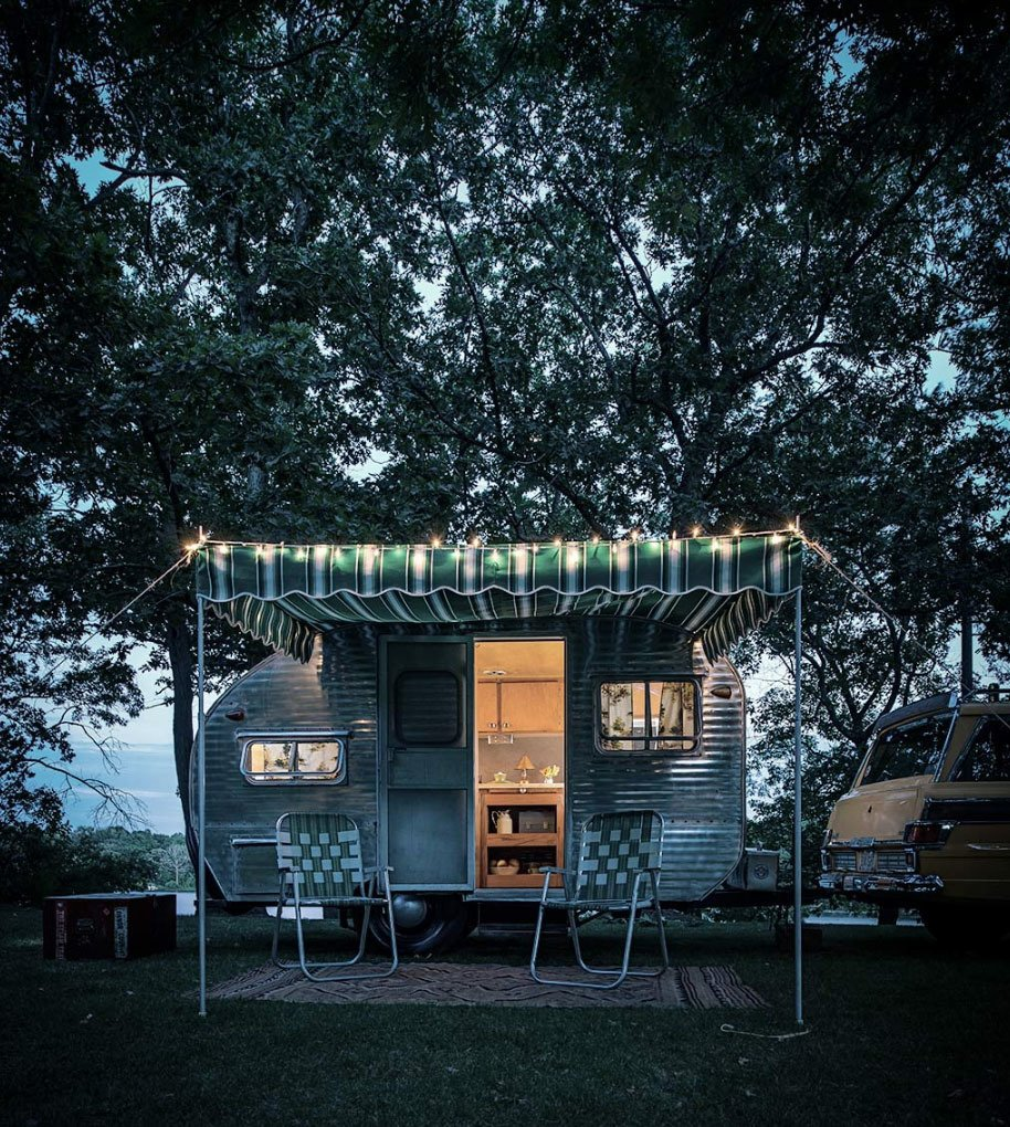 An exterior shot of a trailer at the camp.  Photo 6 of 6 in 5 Tiny Homes on Wheels from This is How You Combine Modern Architecture, Flea Market Finds, and Art All Together