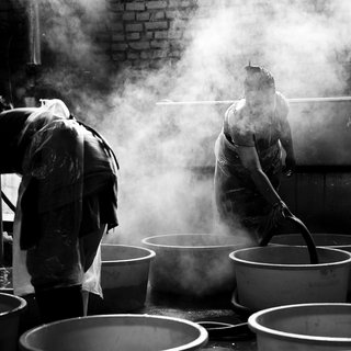 Being the first development project that Menu has taken on, they worked intently for three years to build a system that would truly be beneficial for the Nepali women. Taken in Nepal's capital Kathmandu, women are shown here dyeing wool with a technique developed by the local community. Next, the wool will be woven into throws and blankets.