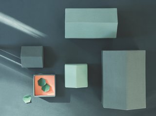 Note Design Studio's Modern Houses and Traditional Houses are architectural boxes that are constructed of cotton shells and paper lining. They're available in a range of hues and come in sets of three or four.