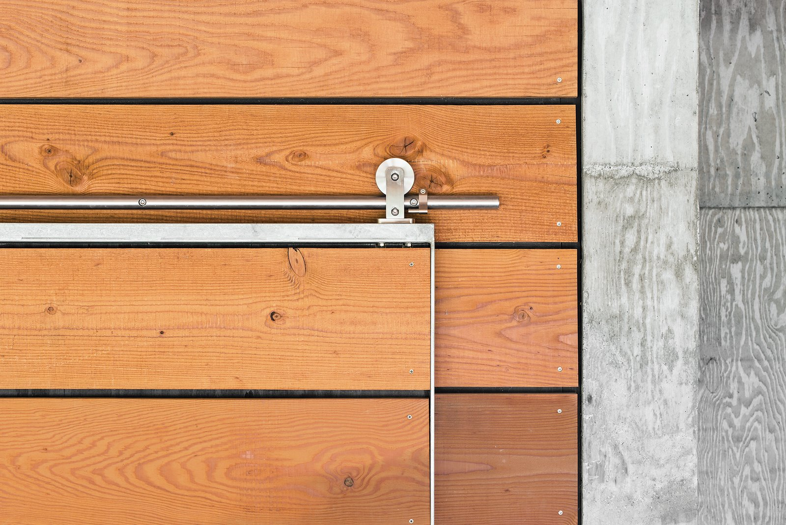 Architect Michael Cobb used Douglas fir harvested from the site throughout the house, such as on a sliding door outfitted with Swiss Rod SS hardware from the Real Carriage Door Company. Tagged: Doors, Sliding Door Type, and Wood. Yes, It Is Easy Being Green - Photo 3 of 5