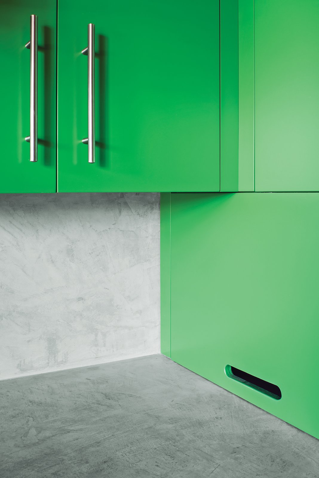 In the kitchen, Santa Rosa-based Reliance Fine Finishing applied a conversion varnish tinted with a green hue. Tagged: Kitchen, Colorful Cabinet, and Concrete Backsplashe.  Photo 4 of 5 in Yes, It Is Easy Being Green