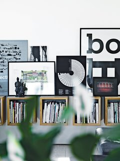 In the main living area, Olsen's own artwork picks up on the graphic diversity of the magazines housed in Boox shelving by Jesper Holm.
