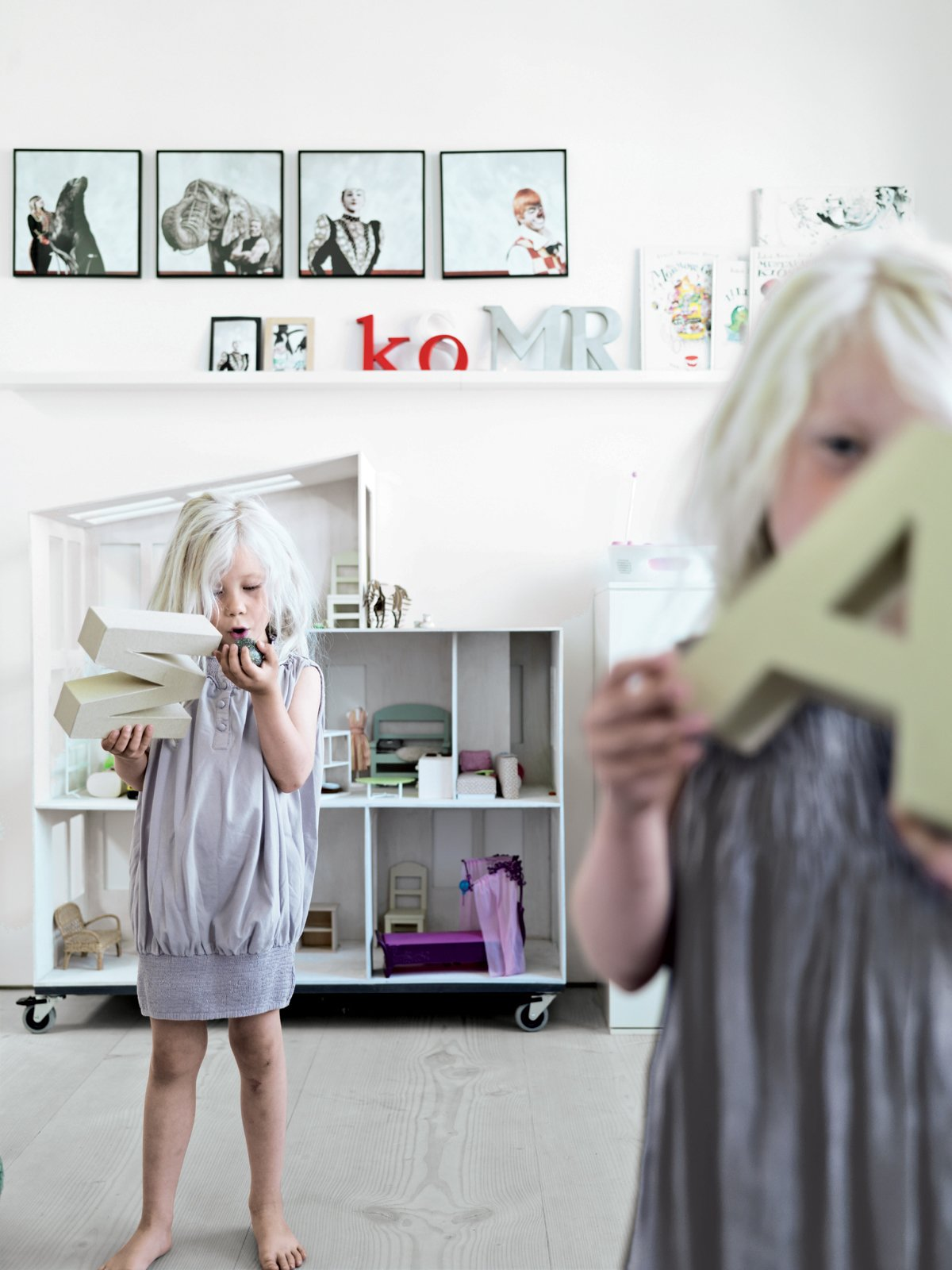 The main feature of twins Merle and Anine's shared bedroom is a massive modern dollhouse, built by their dad for their second birthday.  Photo 7 of 8 in Two Designers Sharpen Up This Former Pencil Factory