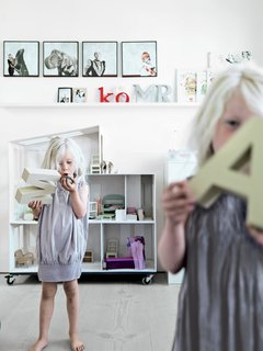 The main feature of twins Merle and Anine's shared bedroom is a massive modern dollhouse, built by their dad for their second birthday.