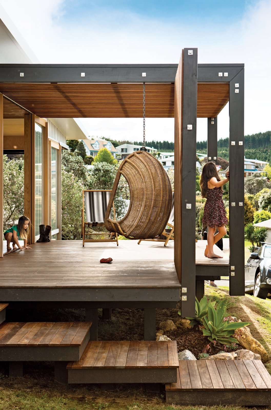 The topography proved challenging so the designers elevated the house on piers.  Photo 3 of 8 in Students Pass Their Class by Building a House in New Zealand