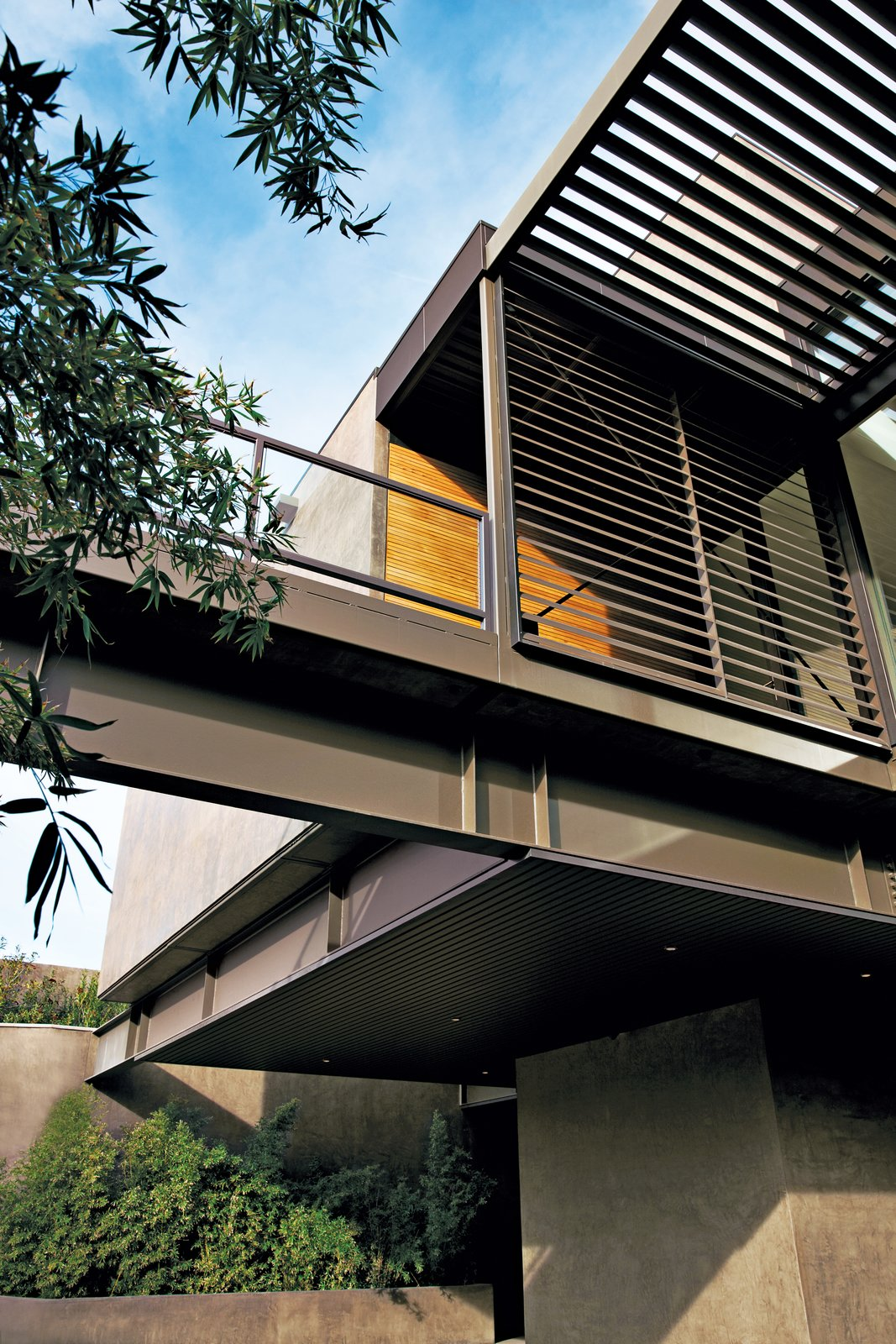 Twenty-two 12-foot-wide steel-frame modules were combined to form nine to 14-foot-high rooms that were stacked and bolted together. Ten deck modules added more than 4,700 square feet of sheltered outdoor space. Image courtesy of Jill Paider.