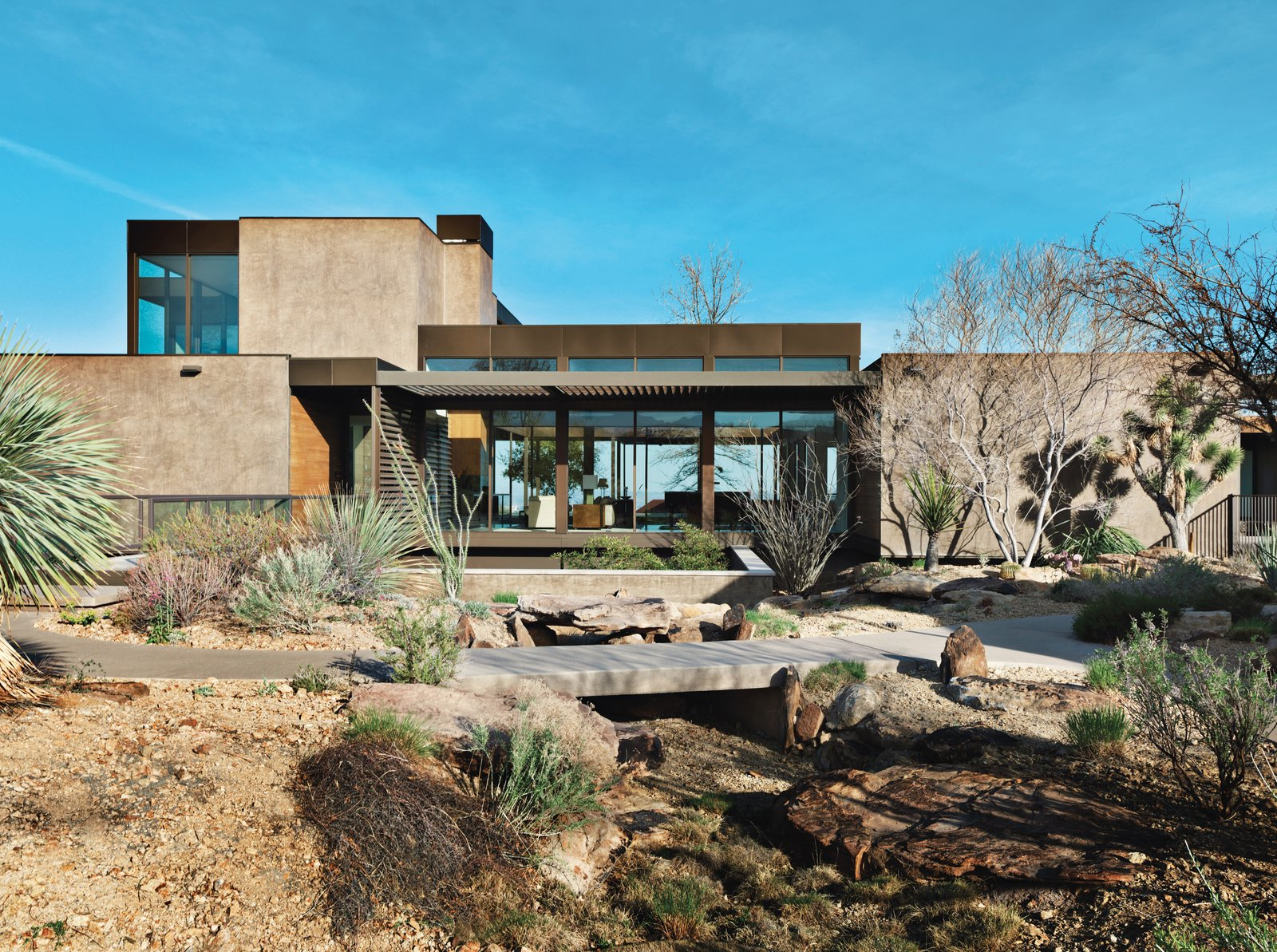 Sage Design Studios transformed the developer-flattened landscape into a picturesque desert setting with naturalistic undulations, meandering trails,and drought-tolerant shrubs. Tagged: Outdoor, Trees, and Desert. A Desert Prefab Hits the Jackpot in Sin City - Photo 5 of 6