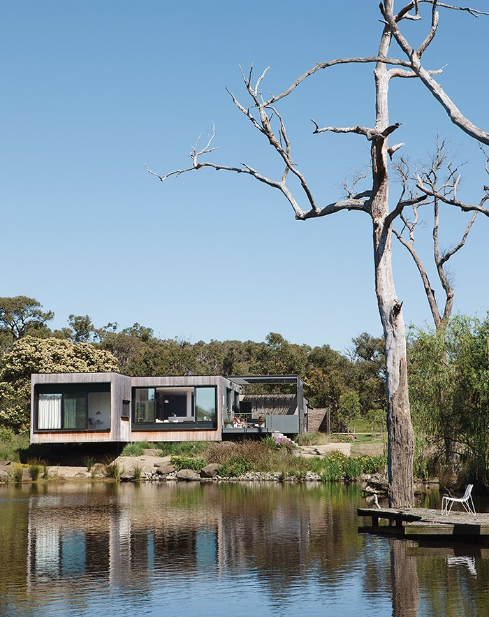 Perched above a lake on Australia's verdant Mornington Peninsula, James and Imogen Tutton's teak-clad house was designed by Karen Alcock of Melbourne-based MA Architects. A House That Looks as Natural as the Landscape - Photo 2 of 9