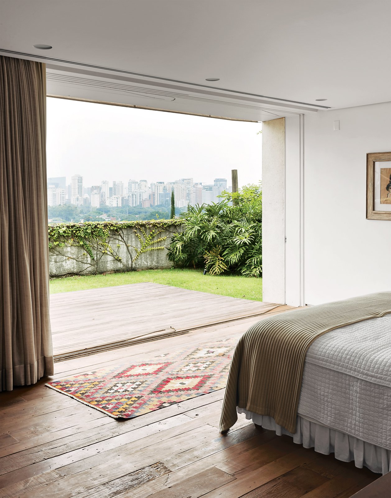 The master bedroom enjoys views of the city.