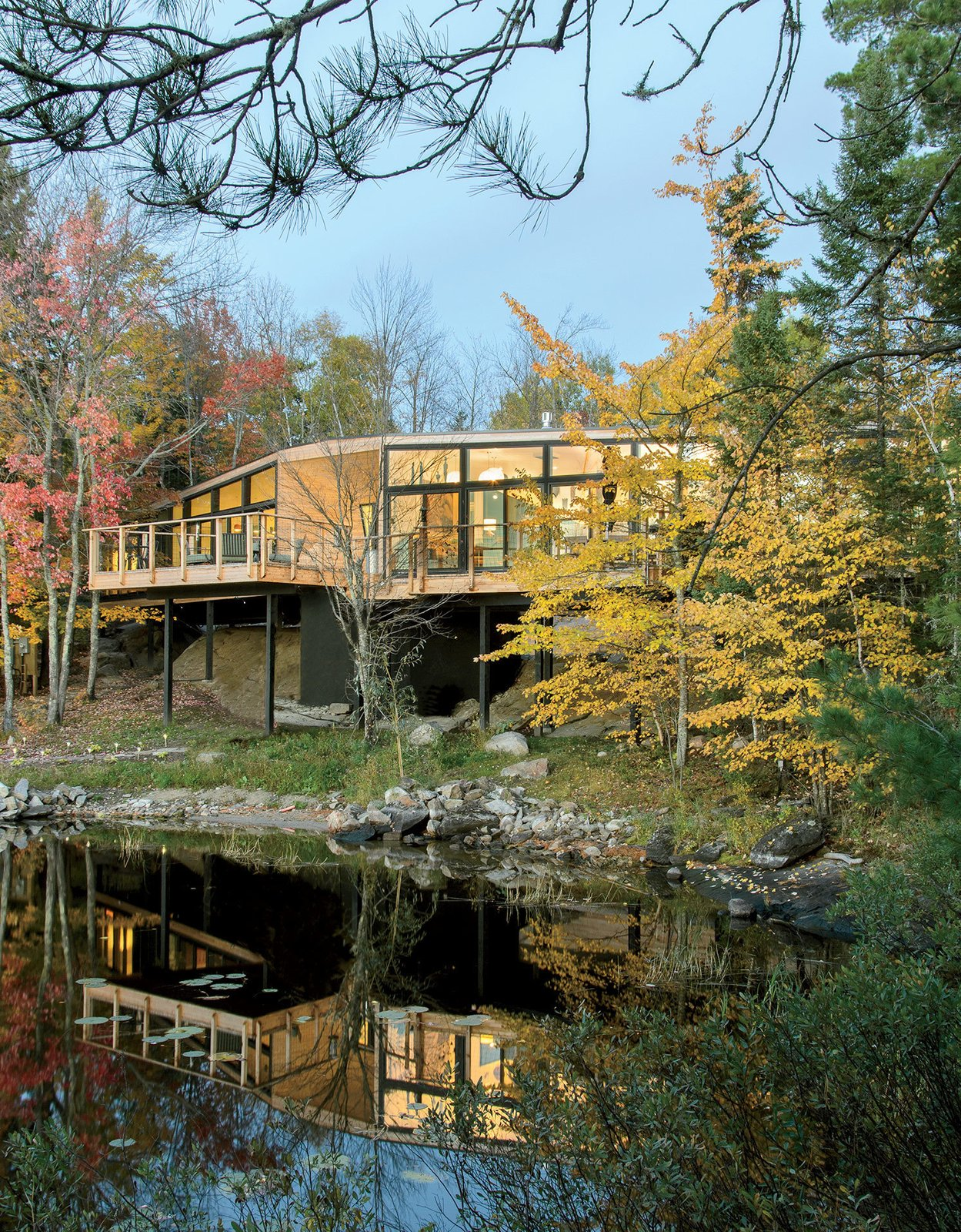 Retirees Dr. Mary Ellen Kennedy and Robert Dault tasked architect Charlie Lazor with bringing a prefabricated 2,100-square-foot home to their lakeside property, located in one of rural Ontario's unorganized territories.  Prefab by Dan Perjar from This Isolated Prefab Is One with the Wild