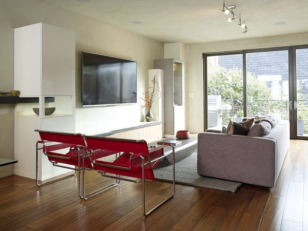 The living room is furnished with Wassily chairs by Marcel Breuer, a Limbo coffee table from Roche Bobois, and a Reid sofa from Design Within Reach.