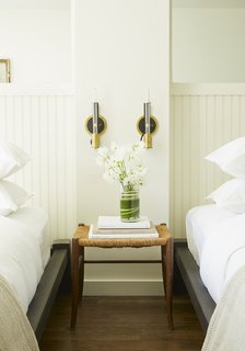 Vermont manufacturer Conant Lighting produced the wall sconces, which are ASH's design, next to each bed.