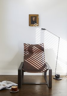In addition to the uniform beds, sconces, writing desks, and chairs found in each room, you'll find unique antiques like this Tomasso Cimini floor lamp and chair by Jean-Pierre Nicolini.