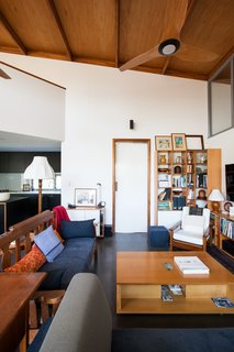 """Thin, Mint: A Eco-Friendly House Rises in Compact Quarters - Photo 4 of 5 - The house was designed with an open floor plan to facilitate aging in place.</p><p><font color=""""#cccccc""""><span style=""""font-size: 13px; line-height: 26px;"""">Courtesy of Mountford Architects</span></font></p><p><font color=""""#cccccc""""><span style=""""font-size: 13px; line-height: 26px;""""><br></span></font> <span style=""""font-family: 'Milo Serif Pro', serif; font-size: 22px; line-height: 1.8;"""">The living room is capped by a sloping plane of oiled LVL (laminated veneer lumber) and plywood. The angle of this high ceiling is oriented to the north, with a combination of cross ventilation, thermal massing, and sun shading devices used to passively achieve a comfortable temperature. Charcoal-burnished concrete floors also help absorb excess heat.</span>"""