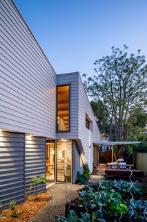 Thin, Mint: A Eco-Friendly House Rises in Compact Quarters - Photo 3 of 5 - Native plantings limit the need to use water for irrigation, while a vegetable garden offers a sustainable source of produce.