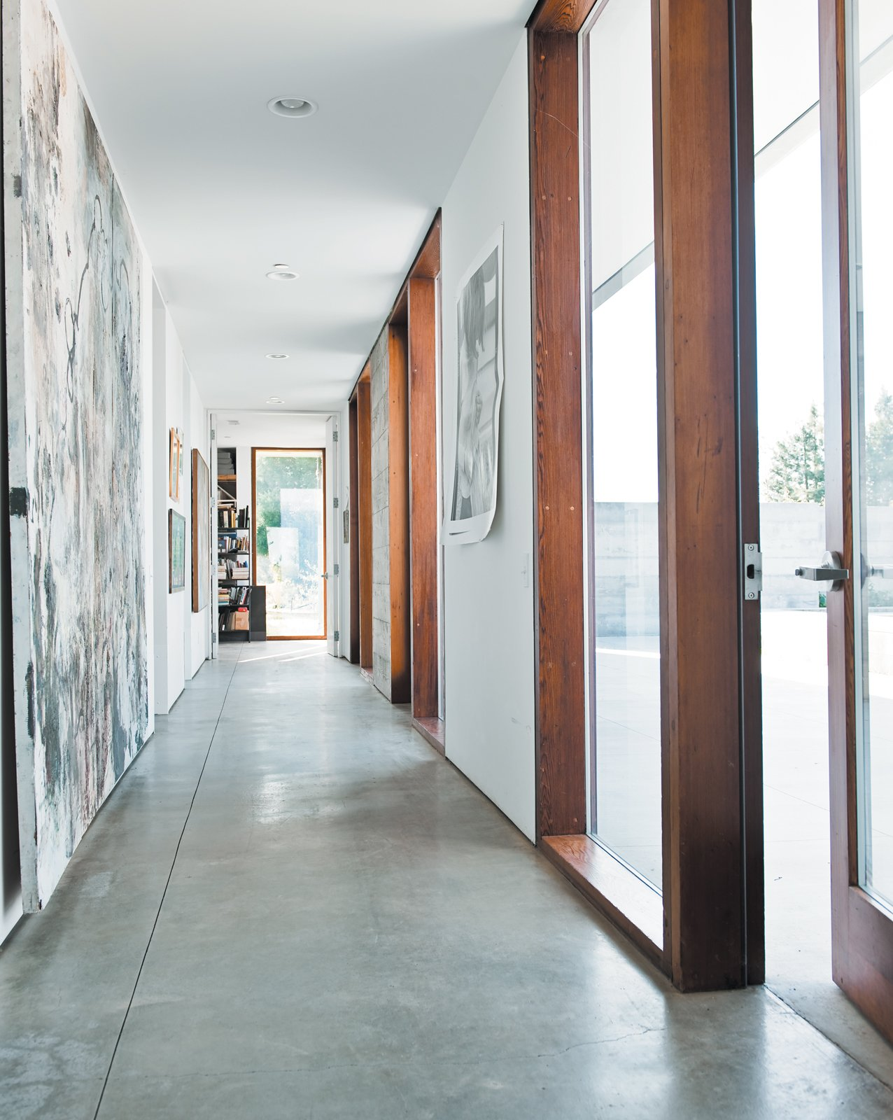 The long hallway leading to the bedrooms gets spectacular afternoon sun, lighting up the family's many works of art. A Sonoma Prefab That Celebrates a Family's Passion for Cooking - Photo 10 of 18