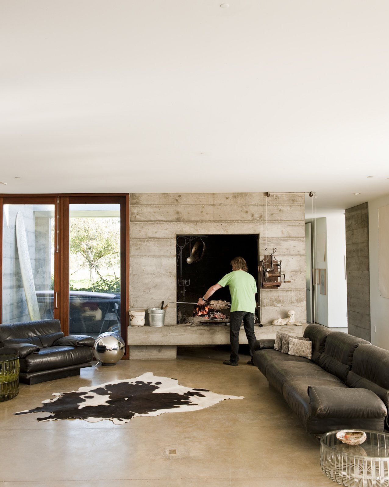 "The oversize hearth (of which there is an outdoor double) was part of the original design specifications. ""Ben said he wanted a fireplace big enough to cook a wild boar,"" says Mark Anderson of Anderson and Anderson.  Photo 17 of 18 in A Sonoma Prefab That Celebrates a Family's Passion for Cooking"