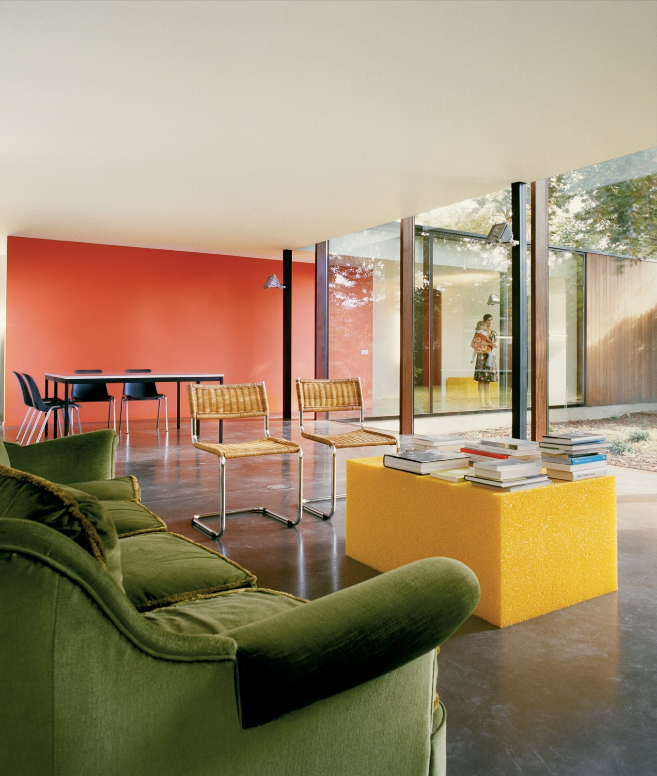 #modern #livingroom #color #greensofa #yellow #bright #orange  Photo by Hertha Hernaus   36+ Interior Color Pop Ideas For Modern Homes by Dwell