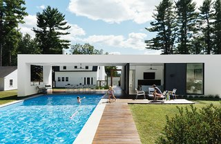 10 Sunny Poolside Prefabs - Photo 4 of 10 -  A prefab pool and guesthouse designed by LABhaus frames views of a Massachusetts property's original structure, a Dillman model Sears Roebuck kit house from 1928.
