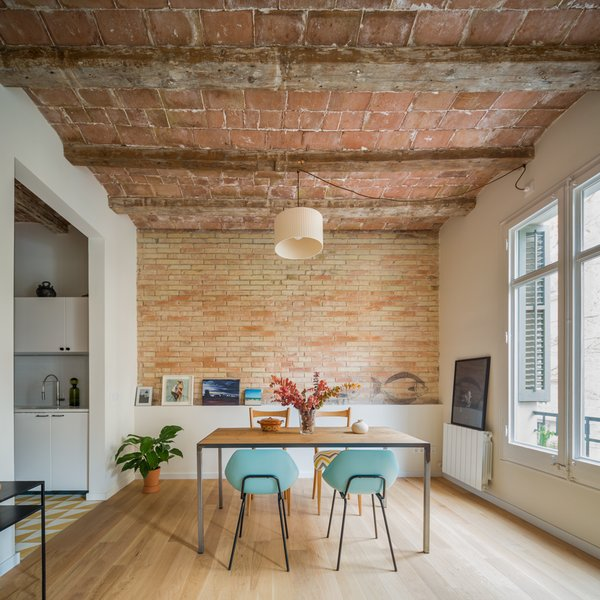 Nook Architects renovated an apartment in a 1931 building in Barcelona's Eixample district for a young woman who travels often for business.  Photo 2 of 6 in In Barcelona, Vaulted Ceilings Are Always a Win